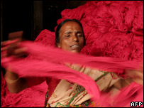 Indian factory worker Dipali Das handles reams of thread as she prepares it for weaving on handlooms in Agartala