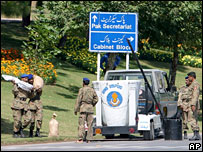 Pakistani security forces carry explosives found near the parliament in Islamabad
