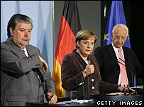 SPD Chairman Kurt Beck, German Chancellor Angela Merkel and Christian Social Union Chairman Edmund Stoiber