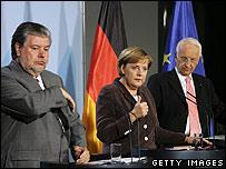 SPD Chairman Kurt Beck, German Chancellor Angela Merkel and Christian Social Union Chairman Edmund Stoiber