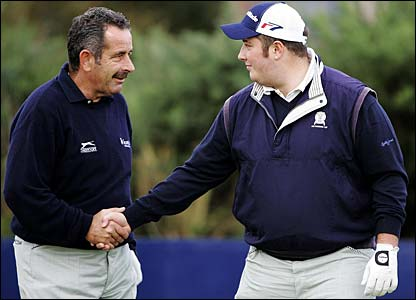 Sam Torrance shakes hands with his son Daniel