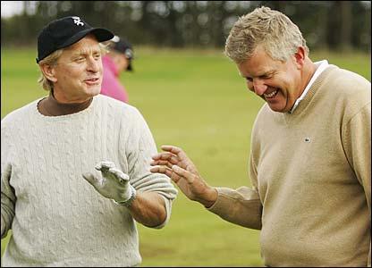 Actor Michael Douglas and Colin Montgomerie share a joke