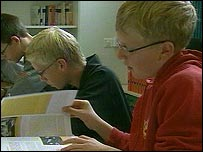 Swiss children study a new history book