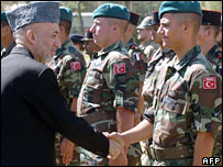 Afghan President Hamid Karzai and Nato troops