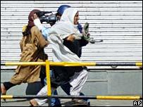 Women flee the shooting