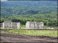 Half-built houses in Santiago Atitlan (picture courtesy Joel Inwood, Pueblo a Pueblo)