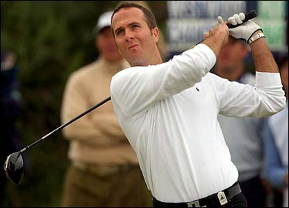 Michael Vaughan watches his drive hit the fairway