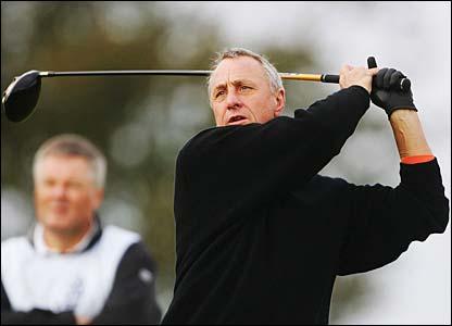 Johan Cruyff hits his tee shot on the second hole