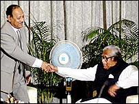 BNP and Awami League negotiators shake hands during earlier talks
