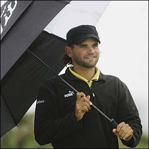 Sweden's Johan Edfors braves the rain