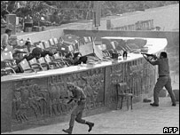 Soldiers open fire on Anwar Sadat and spectators