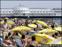 Sunbathers on Brighton beach in the summer