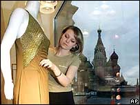 Woman arranges shop window display, Moscow