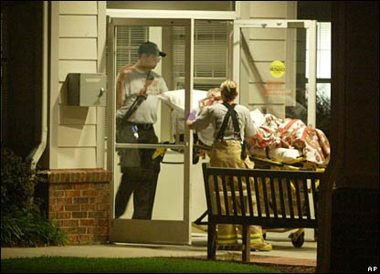 An elderly resident is evacuated from a nursing home in Apex