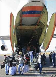 Georgians arrive in Tbilisi onboard a Russian cargo plane