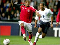 Theo Walcott (right) takes on Germany's Kevin-Prince Boateng