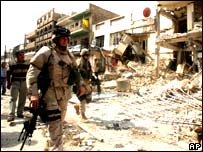 US soldier visits the site of a bomb blast in Baghdad
