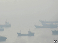 Ships surrounded by haze