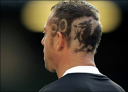 Wales keeper Paul Jones with the Welsh dragon and number 50 shaved into his head