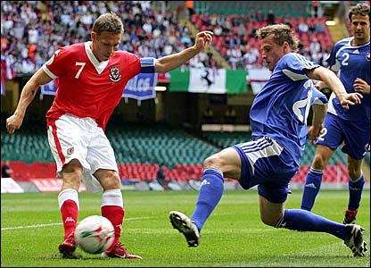 Wales captain Craig Bellamy takes on the Slovakian defence