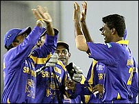 Farveez Maharoof (right) and his team-mates celebrate the wicket of Habibul Bashar