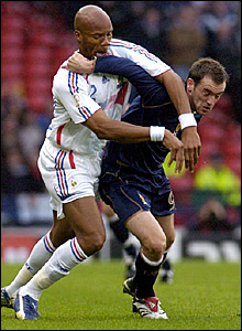 Scotland's James McFadden (right) battles with Jean-Alain Boumsong for the ball