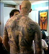 Man with tattoos at the convention