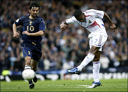 Florent Malouda (right) shoots for France