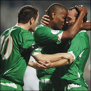 Robbie Keane and Clinton Morrison celebrate with scorer Stephen Ireland