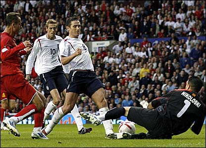 England's Frank Lampard is denied by Macedonia keeper Jane Nikoloski (right)