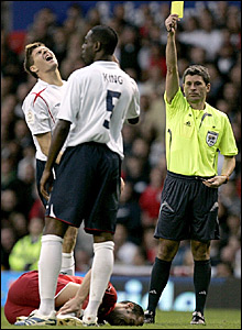 Steven Gerrard (left) reacts as he is booked by referee Markus Merk