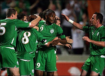 Stephen Ireland (number eight) is mobbed after scoring against Cyprus