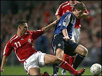 Steven Davis is tackled by Peter Loverkrands in Copenhagen