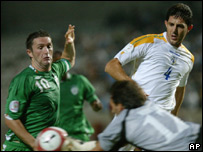 Robbie Keane tries to nip in ahead of Cyprus goalkeeper Michalis Morfis