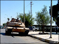 A US Abrams tank patrols a street in the town of Diwaniya