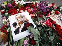 Flowers at an apartment building entrance where journalist Anna Politkovskaya was killed in Moscow