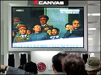 South Koreans watch television in the wake of North Korea's reported nuclear test