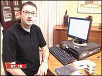 """The BBC's Mark Ward with the """"honeypot"""" computer"""