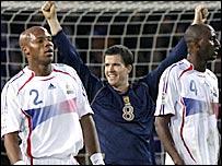 Gary Caldwell celebrates Scotland's win over France