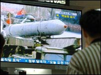 South Koreans watch details of the reported test