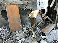 Palestinians pick through rubble of bombed house in Khan Younis