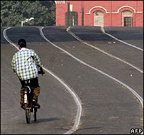 Cyclist on deserted Calcutta tramline