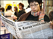A Japanese woman reads a special newspaper edition on North Korea's nuclear test in Tokyo