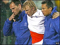 Holland striker Dirk Kuyt is helped off the field after picking up an injury