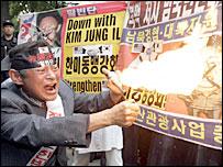 South Korean protester burns picture of N Korean leader Kim Jong-il 9/10/06