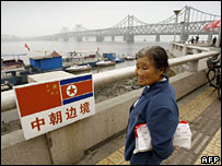 Chiense woman looking over the border into North Korea