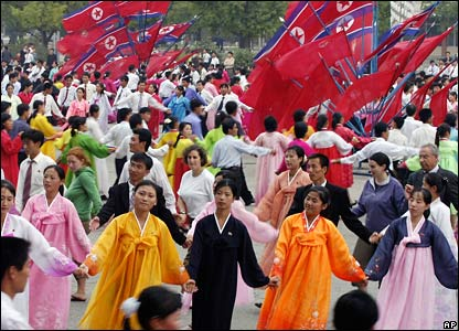 North Korean people dance in ceremony