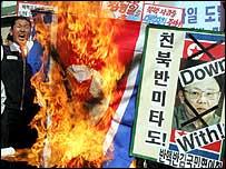 South Korean protesters burn the North Korean flag