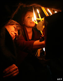 Women burning ceremonial candles.  Image: AFP/Getty