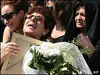 Relatives mourn the victims of the Helios crash